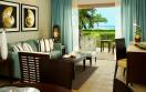 Hilton La Romana Family Resort Premium Master Suite One King Bed Living Area jpg